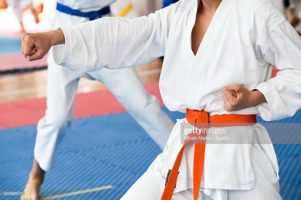 What are the benefits of using 100% cotton uniforms for martial arts?
